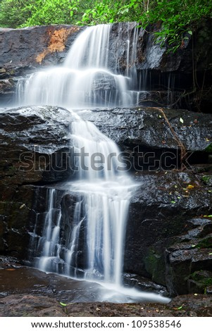 Details of waterfall in tropical forest - stock photo