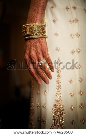 Details shot of henna tattoos on Indian bride - stock photo
