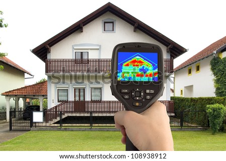 Detecting Heat Loss at the House With Infrared Thermal Camera - stock photo
