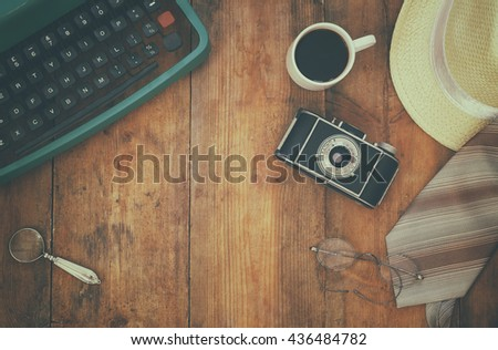 detective concept. Private Detective tools on wooden background. top view. vintage filtered and toned - stock photo
