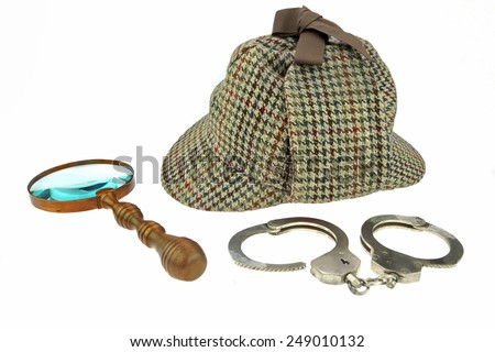 Detective Hat, Retro Magnifier and Real Handcuffs Isolated on White Background - stock photo