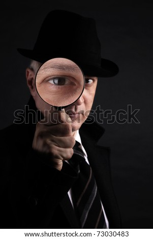 Detective investigate with magnifying glass - stock photo