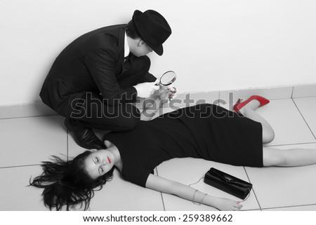 Detective investigating the crime scene - stock photo