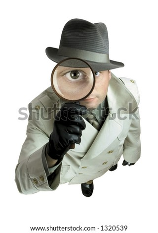 Detective with magnifying glass 1 - stock photo