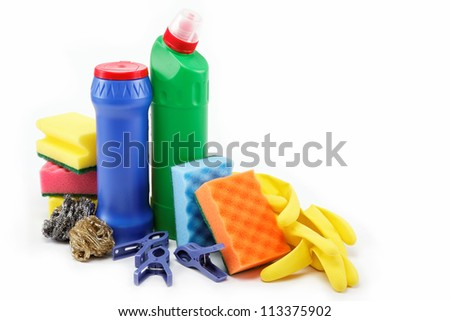 Detergent bottles, rubber gloves and cleaning sponge on a white background.