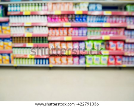detergent shelves in supermarket or grocery store blurred background - stock photo