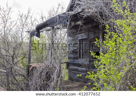 deteriorated abandoned haunted old house.old house,old abandoned house,rural house - stock photo