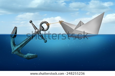 Determination concept business concept as a paper boat  in water pulling a heavy metal anchor as an independence and resolve symbol. - stock photo