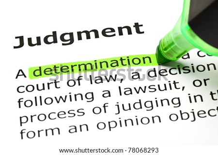 Determination highlighted in green, under the heading Judgment. - stock photo