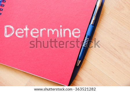 Determine text concept write on notebook with pen - stock photo
