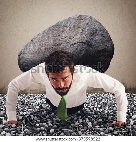 Determined and powerful businessman - stock photo