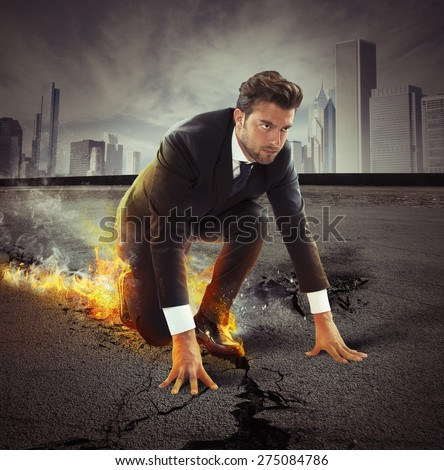 Determined businessman leaving fire trails on asphalt - stock photo