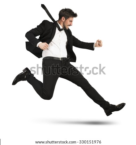 Determined businessman with the suit quickly runs
