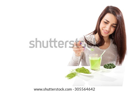 Detox. Beautiful girl with green drink in hand isolated on white. Spirulina, chlorella and wheatgrass. Healthy lifestyle, detox. - stock photo