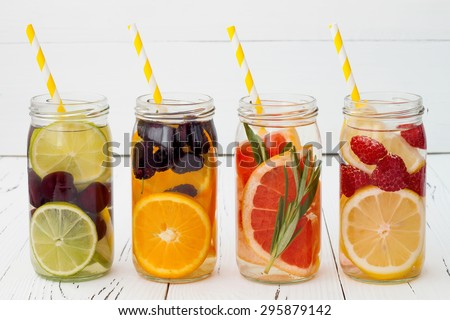 Detox fruit infused flavored water. Refreshing summer homemade cocktail - stock photo