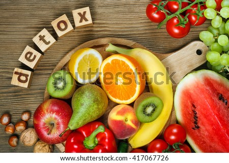Detox. Vitamins in fruits and vegetables. Natural products rich in vitamins as oranges, lemons, red pepper, kiwi,tomatoes, bananas, pears, apples, walnuts, watermelon, hazelnuts, peach and green grape