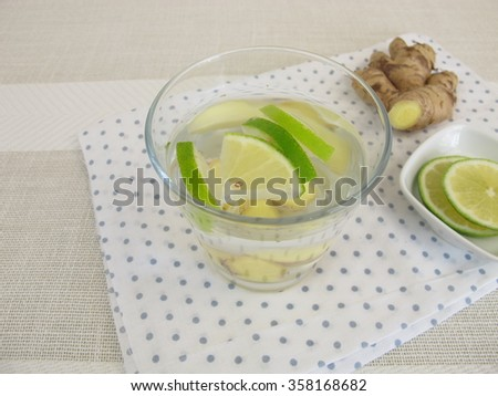 Detox water with ginger root and lemon - stock photo