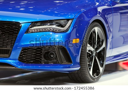 DETROIT - JANUARY 14 : A detrail of the headlight on an Audi RS7 at the North American International Auto Show media preview  January 14, 2014 in Detroit, Michigan. - stock photo
