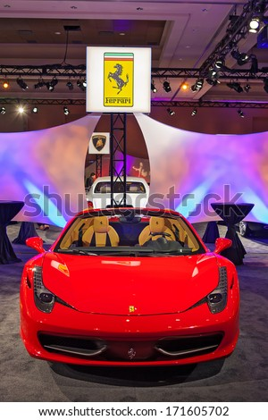 DETROIT - JANUARY 12 : A Ferrari on display at The Gallery media preview in the MGM Grand Casino January 12, 2014 in Detroit, Michigan. - stock photo