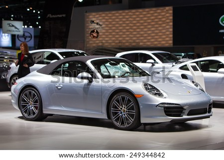 DETROIT - JANUARY 15: A Porsche 911 Cabriolet on display January 15th, 2015 at the 2015 North American International Auto Show in Detroit, Michigan. - stock photo