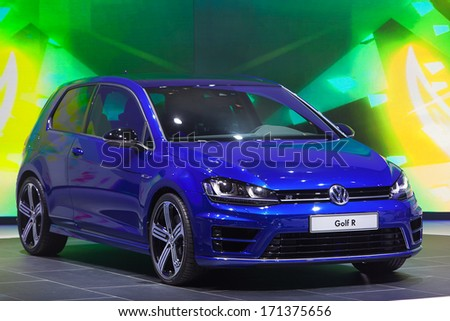 DETROIT - JANUARY 14 : A Volkswagen Golf R on display at the North American International Auto Show media preview  January 14, 2014 in Detroit, Michigan. - stock photo