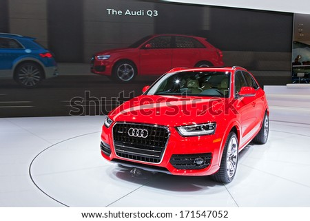DETROIT - JANUARY 14 : Audi debuts the new Q3 at the North American International Auto Show media preview  January 14, 2014 in Detroit, Michigan. - stock photo