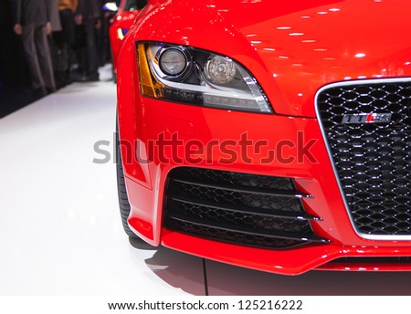 DETROIT - JANUARY 14 : Detail photo of an Audi TT RS headlight at The North American International Auto Show  January 14, 2013 in Detroit, Michigan. - stock photo