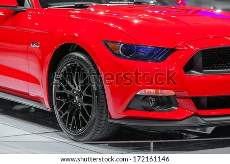 DETROIT - JANUARY 14 : Headlight detail on and 2015 Mustang on display at the North American International Auto Show media preview  January 14, 2014 in Detroit, Michigan. - stock photo