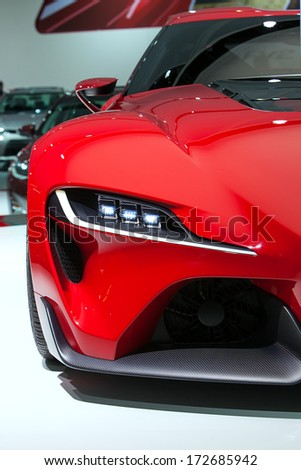 DETROIT - JANUARY 16 : Headlight detail on the Toyota FT-1 concept at the North American International Auto Show media preview  January 16, 2014 in Detroit, Michigan. - stock photo