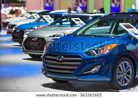 DETROIT - JANUARY 13: Hyundai cars lined up on display at the North American International Auto Show media preview January 13, 2016 in Detroit, Michigan. - stock photo