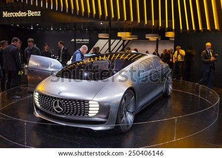 DETROIT - JANUARY 12: Members of the press look at a Mercedes concept on display January 12th, 2015 at the 2015 North American International Auto Show in Detroit, Michigan. - stock photo
