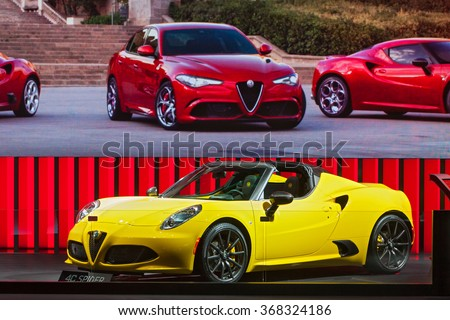 DETROIT - JANUARY 12: The Alfa Romeo 4C Spider on display at the North American International Auto Show media preview January 12, 2016 in Detroit, Michigan. - stock photo