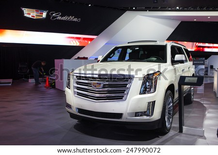 DETROIT - JANUARY 13: The Cadillac Escalade on display January 13th, 2015 at the 2015 North American International Auto Show in Detroit, Michigan. - stock photo