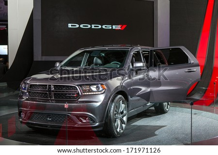 DETROIT - JANUARY 13 : The 2014 Dodge Durango on display at the North American International Auto Show media preview  January 13, 2014 in Detroit, Michigan. - stock photo