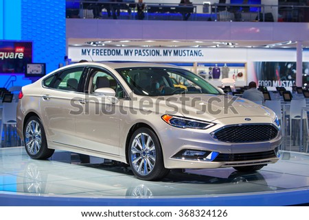DETROIT - JANUARY 12: The 2017 Ford Fusion on display at the North American International Auto Show media preview January 12, 2016 in Detroit, Michigan. - stock photo
