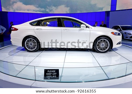 DETROIT - JANUARY 11: The 2013 Ford Fusion SE sedan at the 2012 North American International Auto Show Industry Preview on January 11, 2012 in Detroit, Michigan. - stock photo