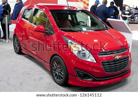 DETROIT - JANUARY 27 :The new 2014 Chevrolet Spark Z-Spec at The North American International Auto Show January 27, 2013 in Detroit, Michigan. - stock photo