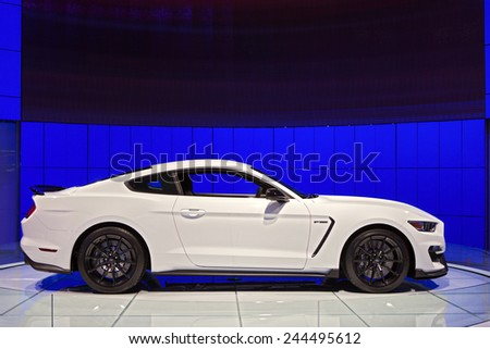 DETROIT - JANUARY 13: The New Ford Mustang GT350 Shelby Cobraon display January 13th, 2015 at the 2015 North American International Auto Show in Detroit, Michigan. - stock photo