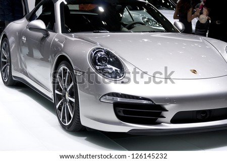 DETROIT - JANUARY 27 :The new 2013 Porsche 911 Carrera 4S Cabriolet at The North American International Auto Show January 27, 2013 in Detroit, Michigan. - stock photo