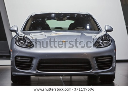 DETROIT - JANUARY 12: The 2016 Porsche Panamera on display at the North American International Auto Show media preview January 12, 2016 in Detroit, Michigan. - stock photo