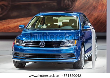 DETROIT - JANUARY 14: The 2016 Volkswagen Passat on display at the North American International Auto Show media preview January 14, 2016 in Detroit, Michigan. - stock photo