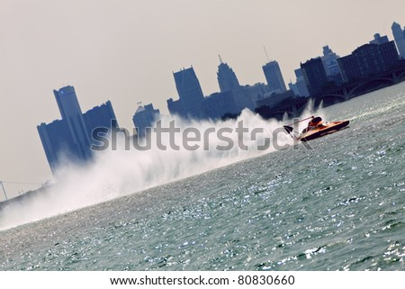DETROIT - JULY 10th : An unlimited hydroplane races against the skyline at the APBA Gold Cup Race Finals on July 10th, 2011 in Detroit, Michigan. - stock photo