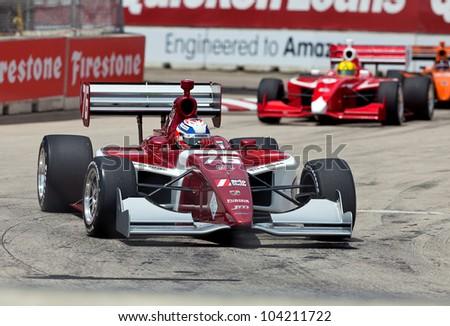 DETROIT - JUNE 2: A close race at the 2012 Detroit Grand Prix on June 2, 2012 in Detroit, Michigan. - stock photo