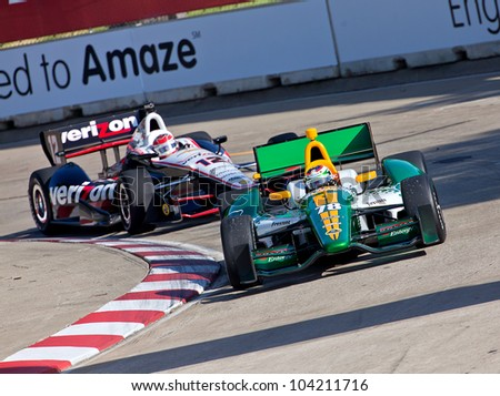 DETROIT - JUNE 2: The Lotus and Verizon Indy cars battle for postition at the 2012 Detroit Grand Prix on June 2, 2012 in Detroit, Michigan. - stock photo