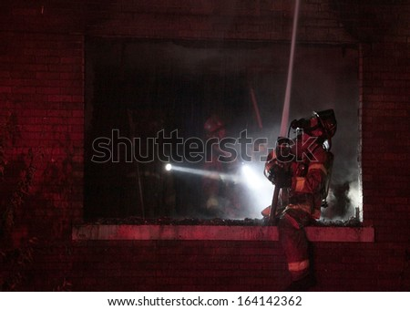 DETROIT, MI - AUGUST 17 2012: Firefighters battle a blaze in a vacant dwelling on Horatio Street on the southwest side of Detroit.