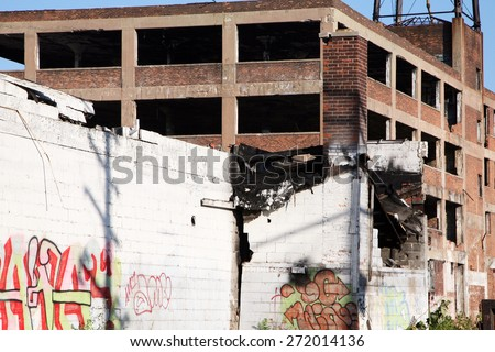 DETROIT, MI-CIRCA JANUARY 2015:  Abandoned auto factory in Detroit awaits the wrecking ball.  Detroit recently received a grant to help offset the demolition costs of their abandoned buildings. - stock photo