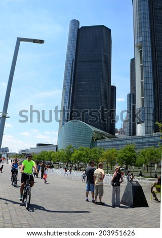 DETROIT, MI - JULY 6: People enjoy the day at the GM Plaza and Promenade, on the Detroit International Riverfront in Detroit, MI on July 6, 2014.  - stock photo