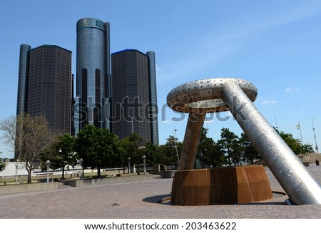 DETROIT, MI - JULY 6: The Renaissance Center, shown here behind Hart Plaza in downtown Detroit on July 6, 2014, houses the world headquarters of General Motors.   - stock photo