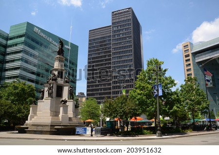 DETROIT, MI - JULY 6: The revitalized Campus Martius park, whose Soldiers and Sailors monument is shown here on July 6, 2014, was dedicated in 2004 as part of the renewal of Detroit.  - stock photo