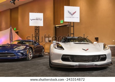 DETROIT, MI/USA - JANUARY 11, 2015: An SRT Dodge Viper GTS and Chevrolet Corvette Z06 at The Gallery, sponsored by the North American International Auto Show (NAIAS) and the MGM Grand Detroit. - stock photo